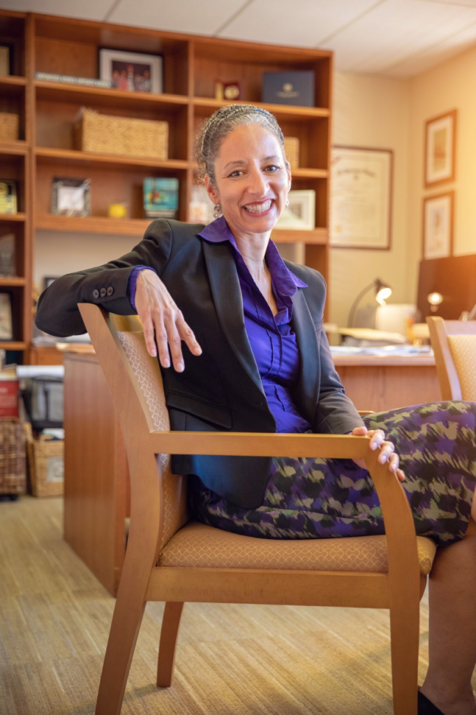 Laura Kohn-Wood, dean of the School of Education and Human Development, in her office at UM. Kohn-Wood considered pursuing a career in boxing before pursuing academia.