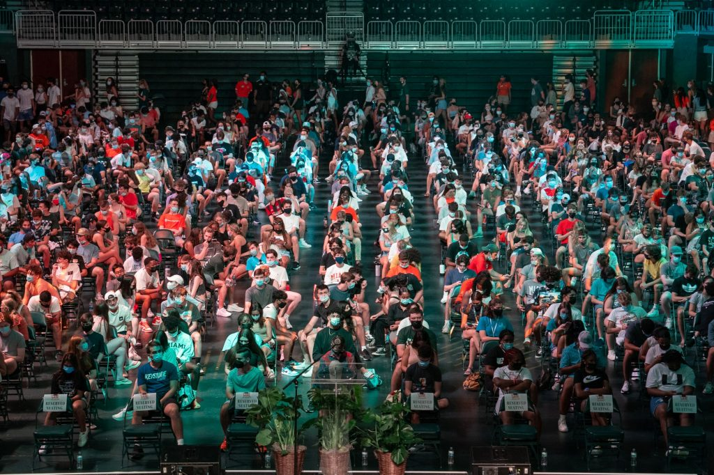 Freshmen of the Class of 2025 await the start of the President's Welcome and Canes Take Flight programs in the Watsco Center on Aug. 19, 2021.