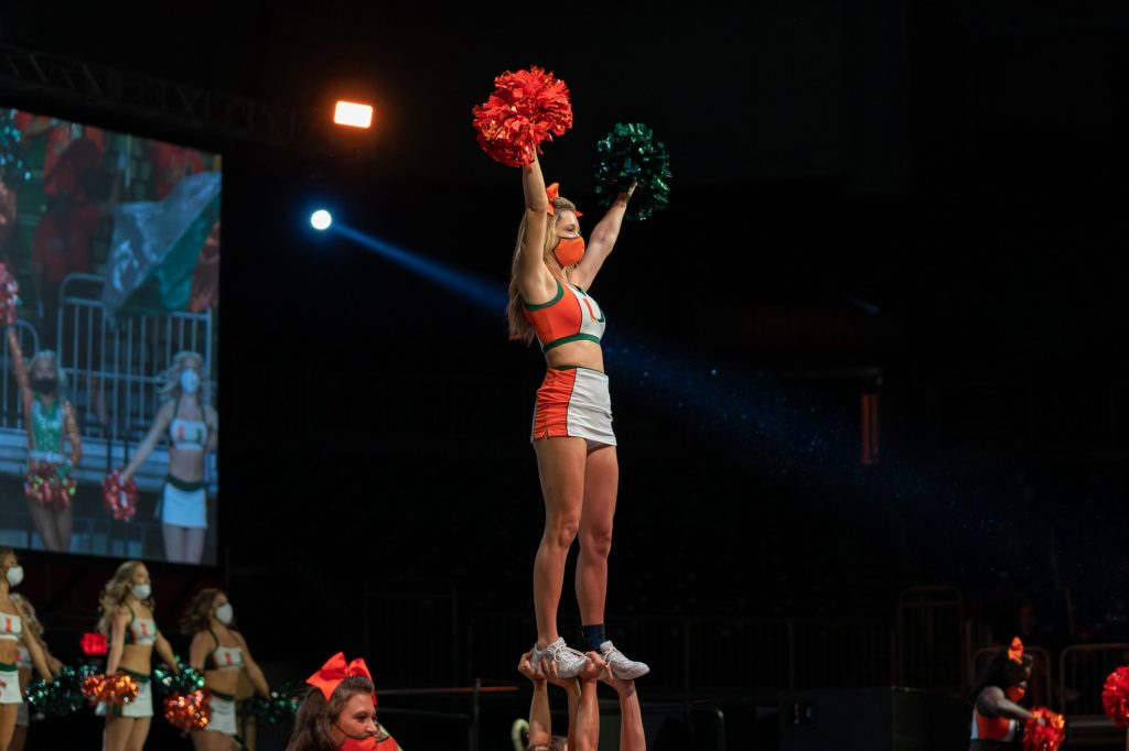 A UM cheerleading flyer welcomes the Class of 2025 during the Canes Take Flight program in the Watsco Center on Aug. 19, 2021.