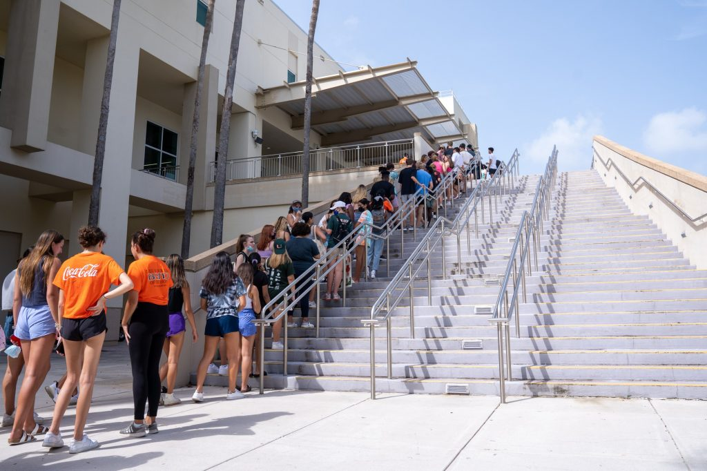 Students line up outside of the Watsco Center on their way to Canefest 2021 on Aug. 22, 2021.