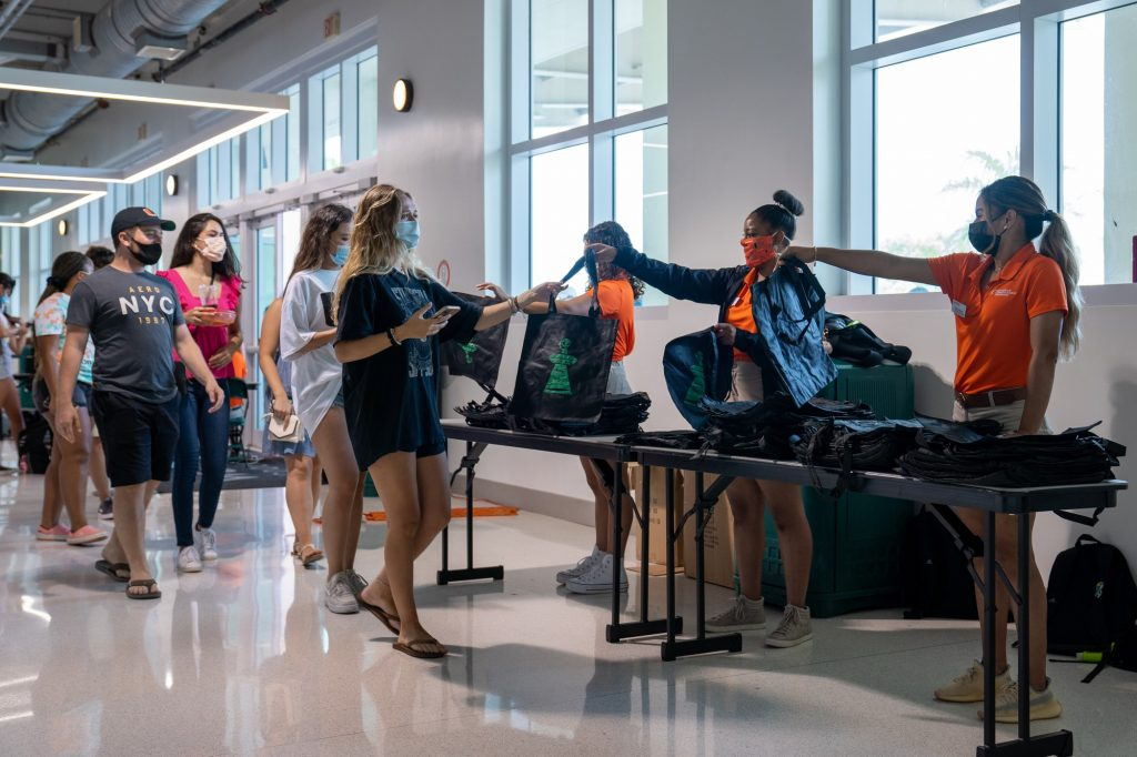 Students receive bags on their way in to Canefest 2021 at the Watsco Center on Aug. 22, 2021. The bags are used to carry branded merchandise that clubs and organizations hand out.