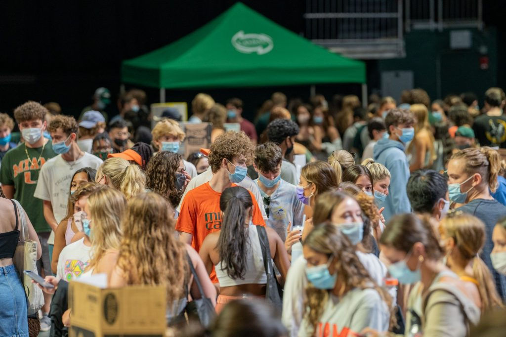 Students walk through rows of booths showcasing a portion of the 300+ student organizations and departments at Canefest 2021 in the Watsco Center, on Aug. 22, 2021.