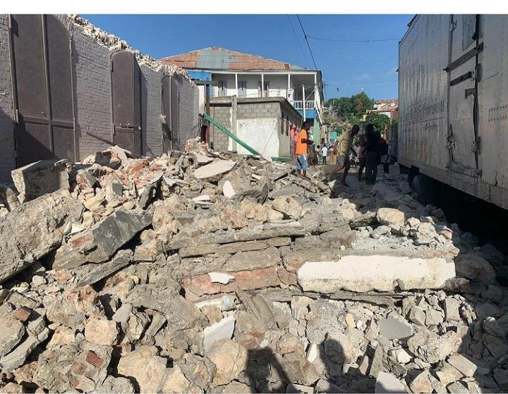 Haitian's work to clean up the rubble caused by a  7.2 magnitude earthquake on Aug. 14.