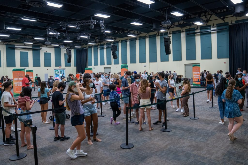 Incoming freshman wait in line to have their Cane ID photos taken in the Watsco Center during 'Cane Kickoff on Aug. 17, 2021.