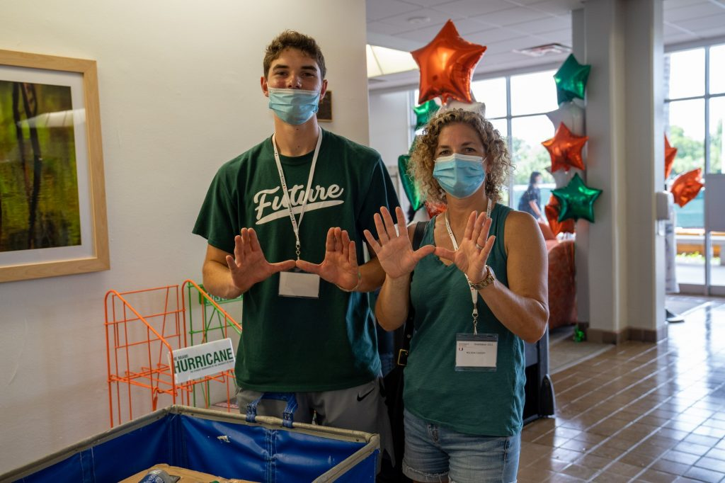 Michael and Melissa Cassidy throw up the U while moving into Stanford Residential College on Aug. 17, 2021.