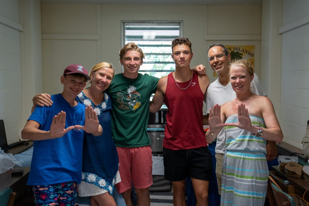 Jack Bettex and roommate Peter Commisso pose with family while settling in their room in Stanford Residential College on Aug. 17, 2021.