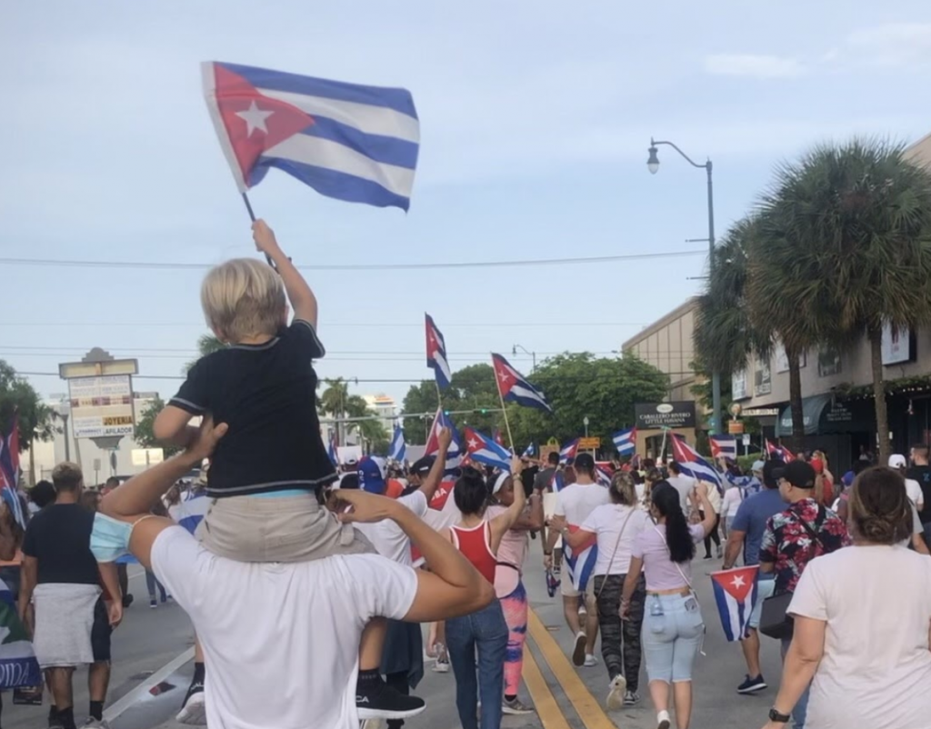 A young boy waves the Cuban flag during a march on July 11th on Calle Ocho in Miami, Florida in support of the protests in Cuba.