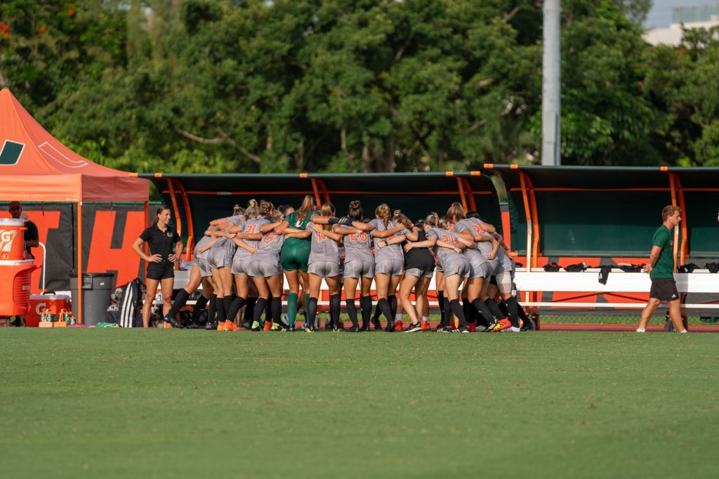 Canes Women's Soccer players huddle up before their match versus FAU at Cobb Stadium on Aug. 22, 2021