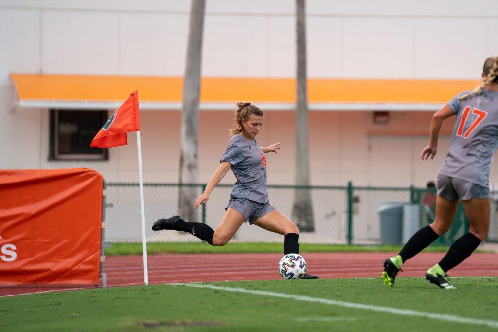 Sophomore forward/midfielder Gabriela Rusek kicks a corner kick during the Canes' match versus FAU at Cobb Stadium on Aug. 22, 2021.