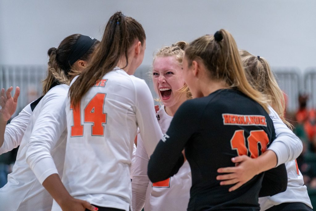 Canes Women's Volleyball players celebrate scoring a point during their game versus UMBC in the Knight Sports Complex on Aug. 29, 2021.