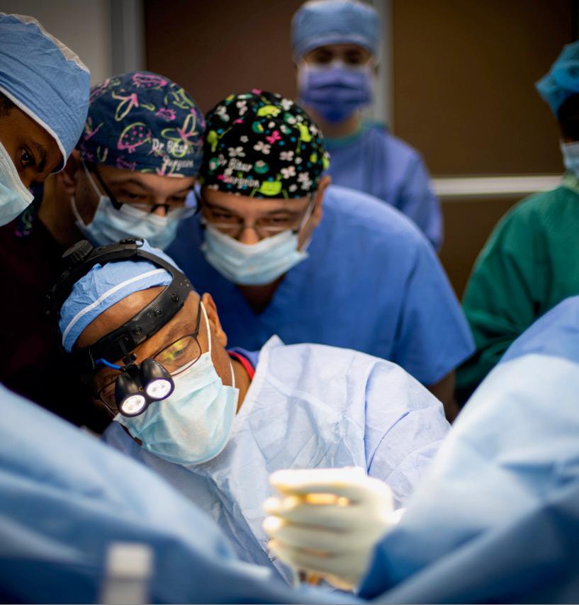 UM Miller School of Medicine Dean Henri Ford performs surgery on a Haitian patient.