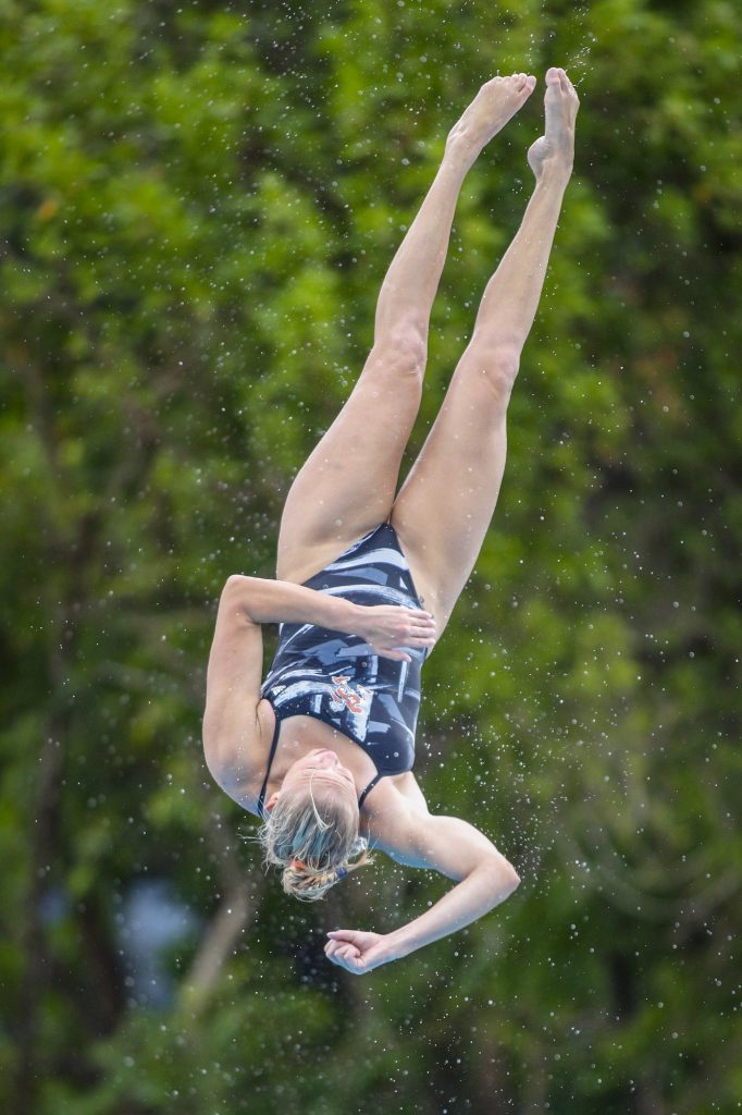 Sophomore Emma Gullstrand does a dive off of the one meter springboard during practice on Monday Sept. 13 at the UC Pool.