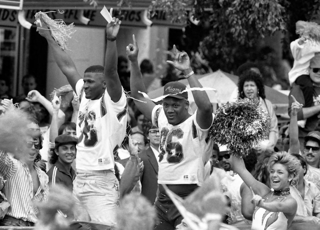 University of Miami defensive back Bennie Blades and defensive end Daniel Stubbs celebrate the National Championship during a ticker tape parade in downtown Miami January 1988. The Hurricanes defeated the Oklahoma Sooners 20-14 for the national title.