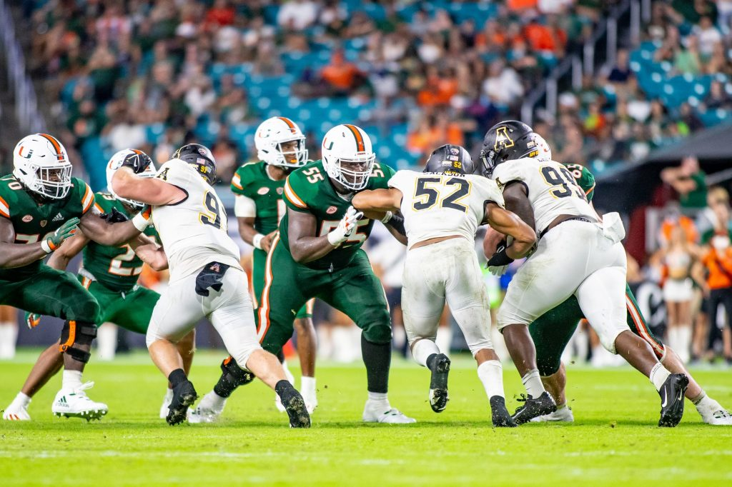 Senior Navaughn Donaldson blocks an Appalachian State defender during the second half of Miami's 25-23 win Saturday Sept. 11.