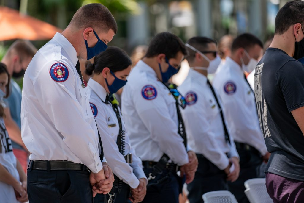 Members of Coral Gables Fire Rescue observe a moment of silence during the 9/11 National Day of Service and Remembrance Memorial at the Rock Plaza on Sept. 10, 2021.