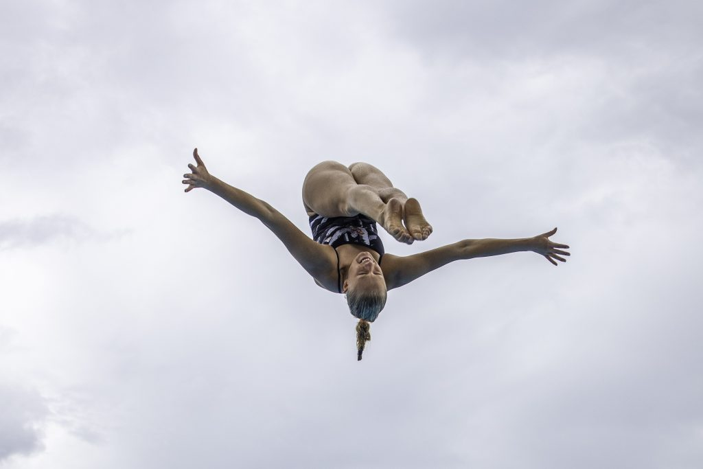 Sophomore Emma Gullstrand dives off of the 10 meter platform during practice on Monday Sept. 13 at the UC Pool.