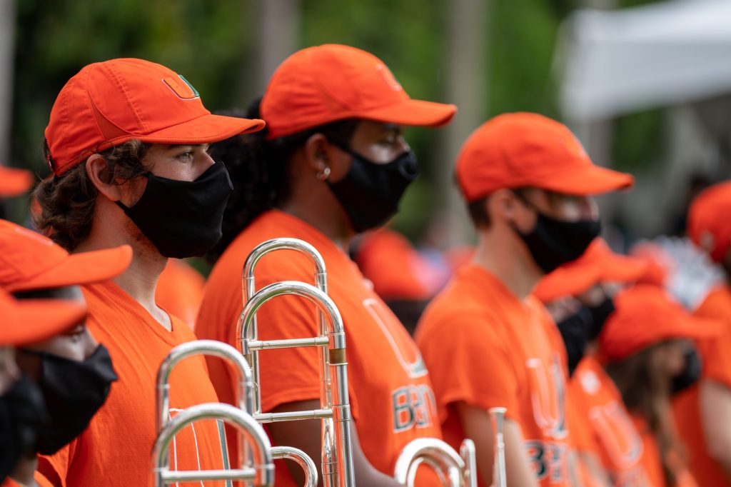 Members of the Frost Band of the hour stand and wait to perform during the Family Weekend Pep Rally & BBQ on the Foote Green on Sept. 24, 2021.