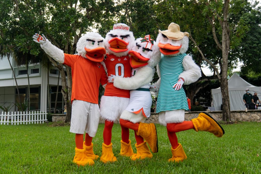"""Sebastian the Ibis and his """"family"""" pose during the Family Weekend Pep Rally & BBQ on the Foote Green on Sept. 24, 2021."""
