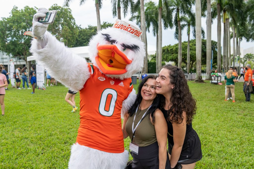 Freshman Lisa Sellers and mother Jade Sellers take a selfie with Sebastian the Ibis during the Family Weekend Pep Rally & BBQ on the Foote Green on Sept. 24, 2021.