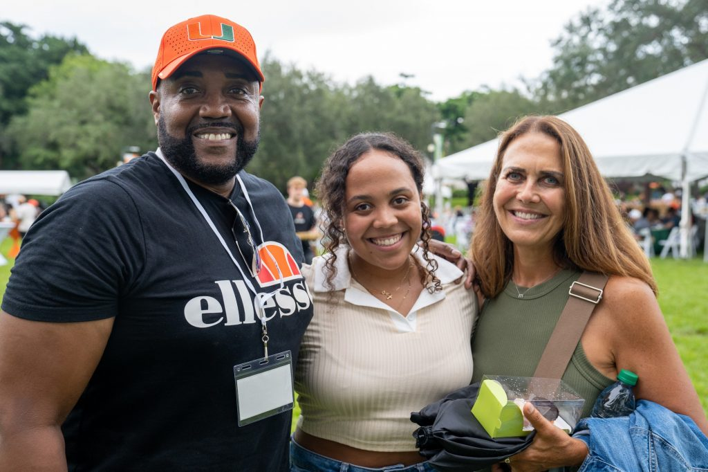 Sophomore Maya Grandson poses with parents Maita and Eric during the Family Weekend Pep Rally & BBQ on the Foote Green on Sept. 24, 2021.