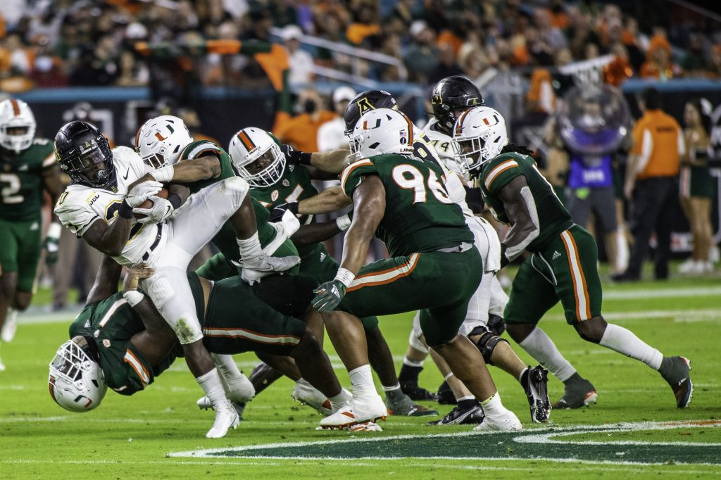 Junior Nesta Silvera tackles Appalachan State's running back, sophomore Nate Noel, at Hard Rock Stadium during the first half at Hard Rock Stadium on Saturday Sept. 11. Silvera had four total tackles on the night in Miami's 25-23 win.