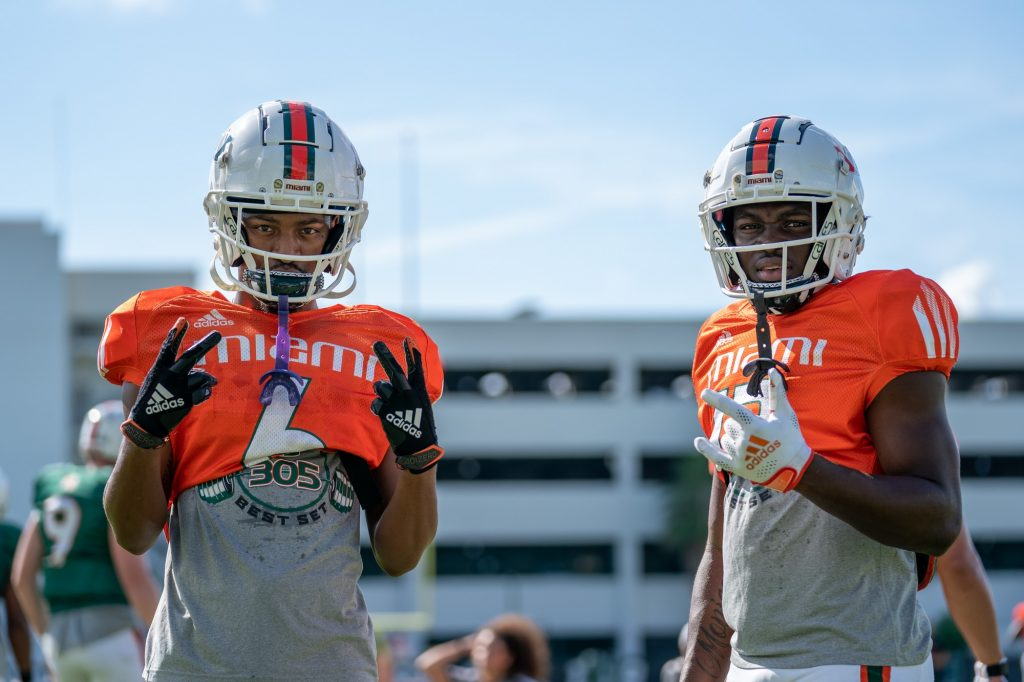 Junior wide receiver Mark Pope and freshman wide receiver Brashard Smith pose during practice at the Greentree Practice Fields on Sept. 14, 2021.