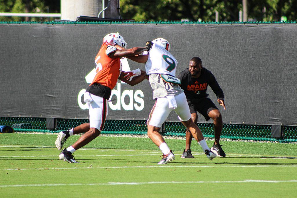 Redshirt freshman cornerback Luis Gutierrez, Jr. blocks freshman wide receiver Jacolby George during practice on Sept. 14, 2021.