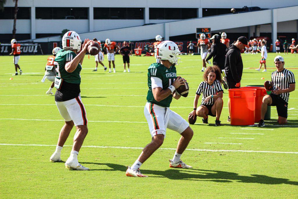 Freshman quarterback Jake Garcia and redshirt sophomore quarterback Ryan Rizk throw passes during practice on Sept. 14, 2021.