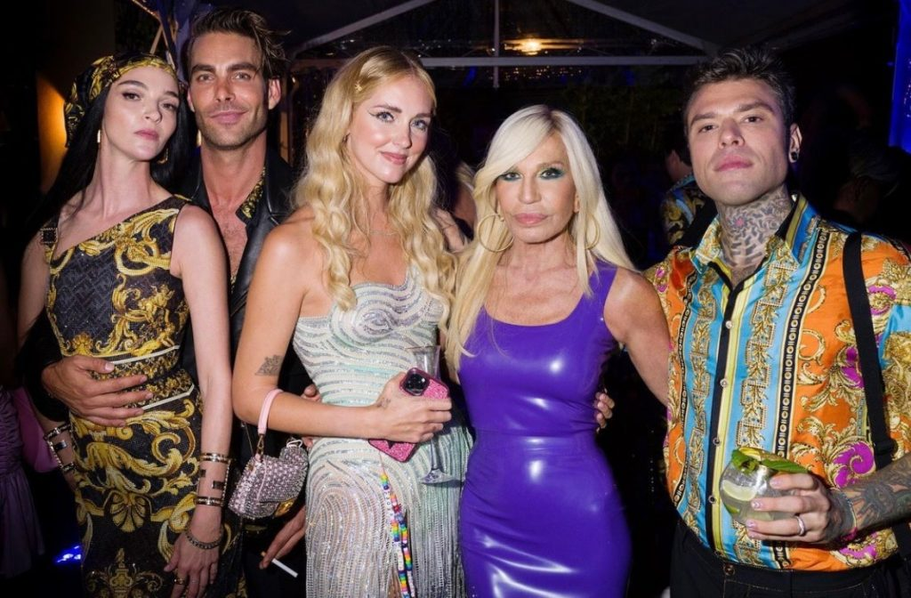 Donatella Versace poses with attendees in Milan