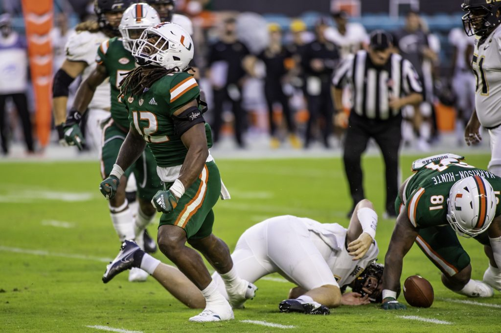 Redshirt freshman Jafari Harvey celebrates after recording Miami's only sack of the game early in the first quarter at Hard Rock Stadium on Saturday Sept. 11. Harvey finished the game with two solo tackles and four total tackles.