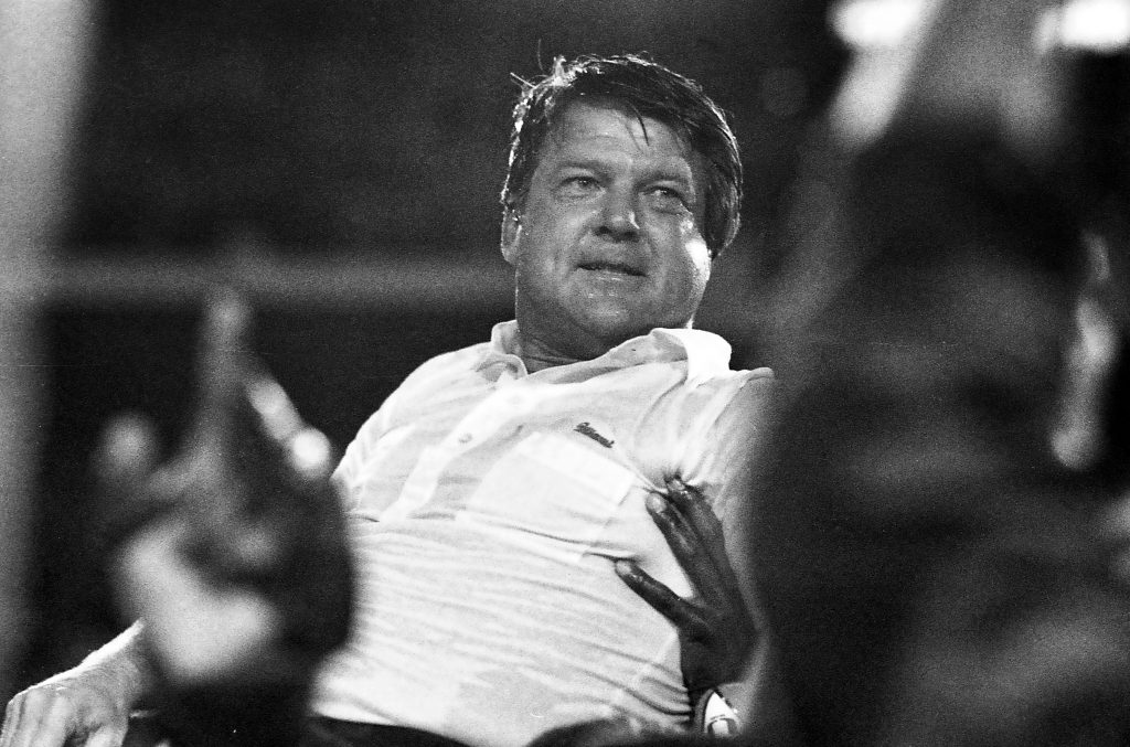 University of Miami Hurricanes head coach Jimmy Johnson is carried off the field after defeating the Oklahoma Sooners 20-14 for the national title January 1, 1988.