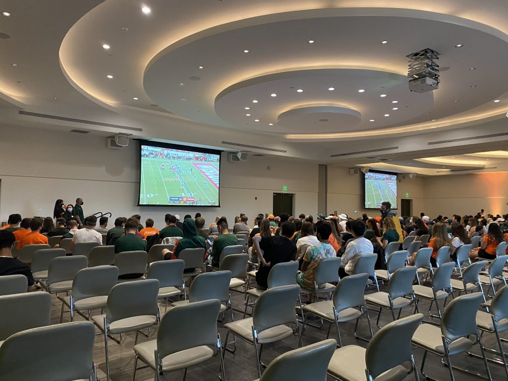 Students gather in the Shalala Student Center Ballrooms to watch the UM Alabama game sponsored by Hurricane Productions and Category 5 on Sept. 4. Unexpected rain forced a last-minute change of venue from the Lakeside Village volleyball courts.