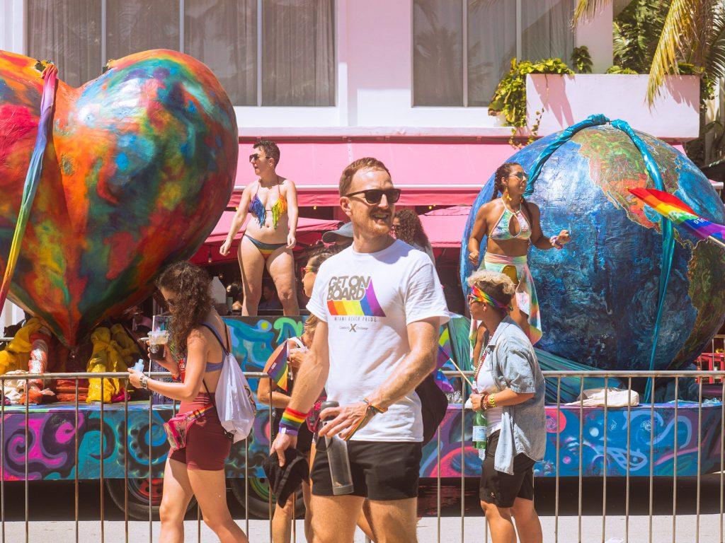 Large floats celebrating Pride drive down Ocean Drive on Sept. 19