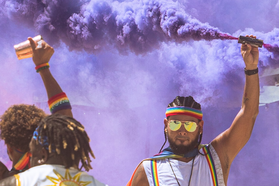 Festival attendees light up Ocean Drive with colorful smoke bomb on Sept. 19