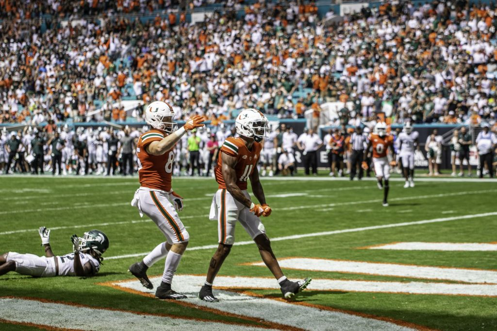 Charleston Rambo (11) celebrates after scoring a touchdown in the second half of Miami's game against Michigan State on Sept. 18 at Hard Rock Stadium.