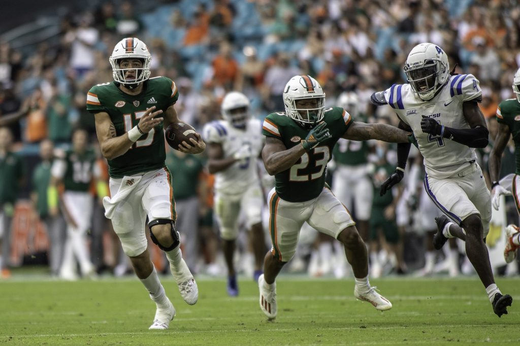 UM freshman quarterback Jake Garcia (13) escapes the pocket and runs down the field during Miami's game against Central Connecticut State on Sept. 25, 2021 at Hard Rock Stadium.
