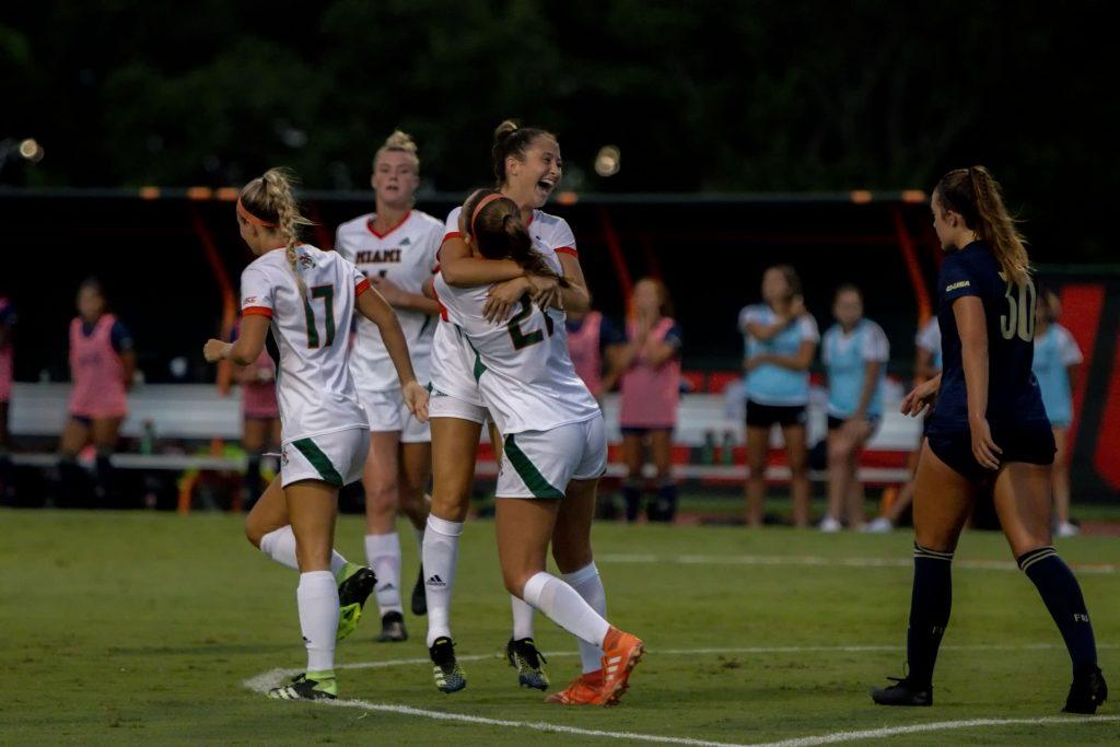 The Hurricanes celebrate after freshman midfielder Lauren Meek's goal at Cobb Stadium on Sept. 9, 2021.