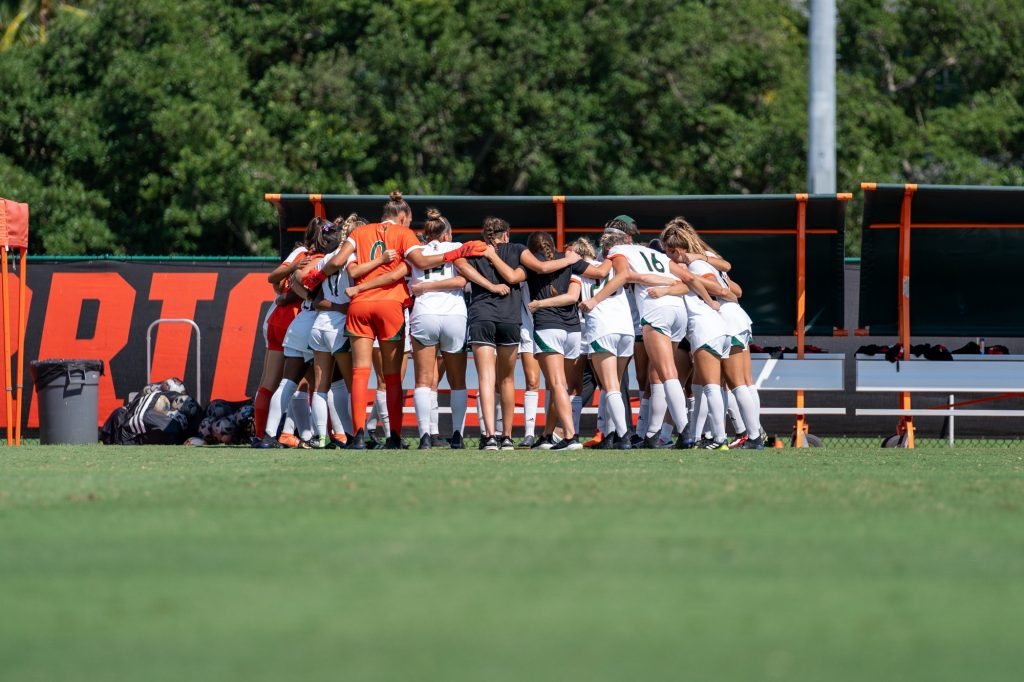 Canes soccer players huddle up before the start of their match versus Pittsburgh at Cobb Stadium on Sept. 26, 2021.