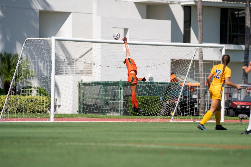 Junior goalkeeper Melissa Dagenais leaps in an attempt to block a shot on goal during the first half of Miami's match versus Pittsburgh at Cobb Stadium on Sept. 26, 2021.