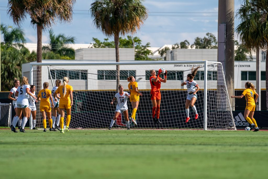 Junior goalkeeper Melissa Dagenais catches the ball after a shot on goal during the second half of Miami's match versus Pittsburgh at Cobb Stadium on Sept. 26, 2021.