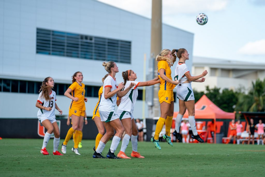 Sophomore forward/midfielder Gabriela Rusek jumps for a header during the second half of Miami's match versus Pittsburgh at Cobb Stadium on Sept. 26, 2021.