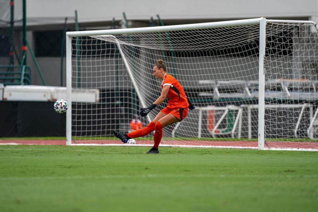 Junior goalkeeper Melissa Dagenais kicks a goal kick during the first half of the Canes' match versus USF at Cobb Stadium on Sept. 12, 2021.