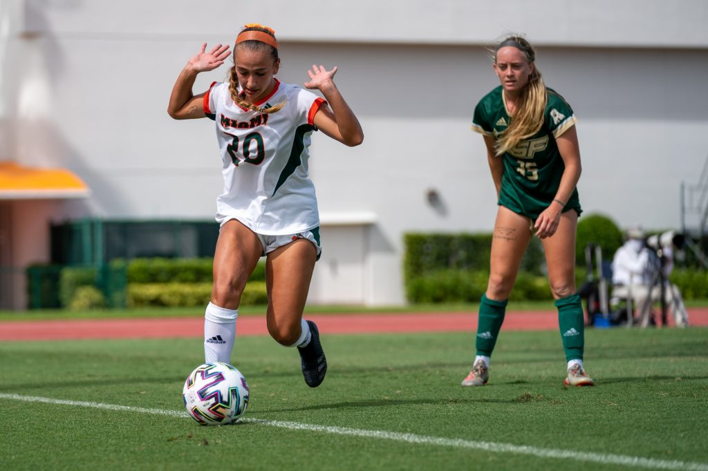 Sophomore midfielder/forward Michaela Baker indicates she was not the last to touch the ball as it heads out of bounds during the second half of the Canes' match versus USF at Cobb Stadium on Sept. 12, 2021.