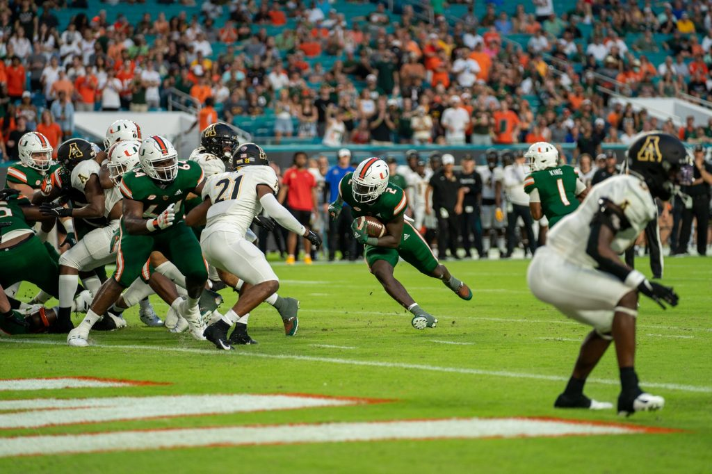 Freshman running back Don Chaney, Jr. finds a gap between defenders and runs into the end zone during Miami's game versus Appalachian State at Hard Rock Stadium on Sept. 11, 2021.