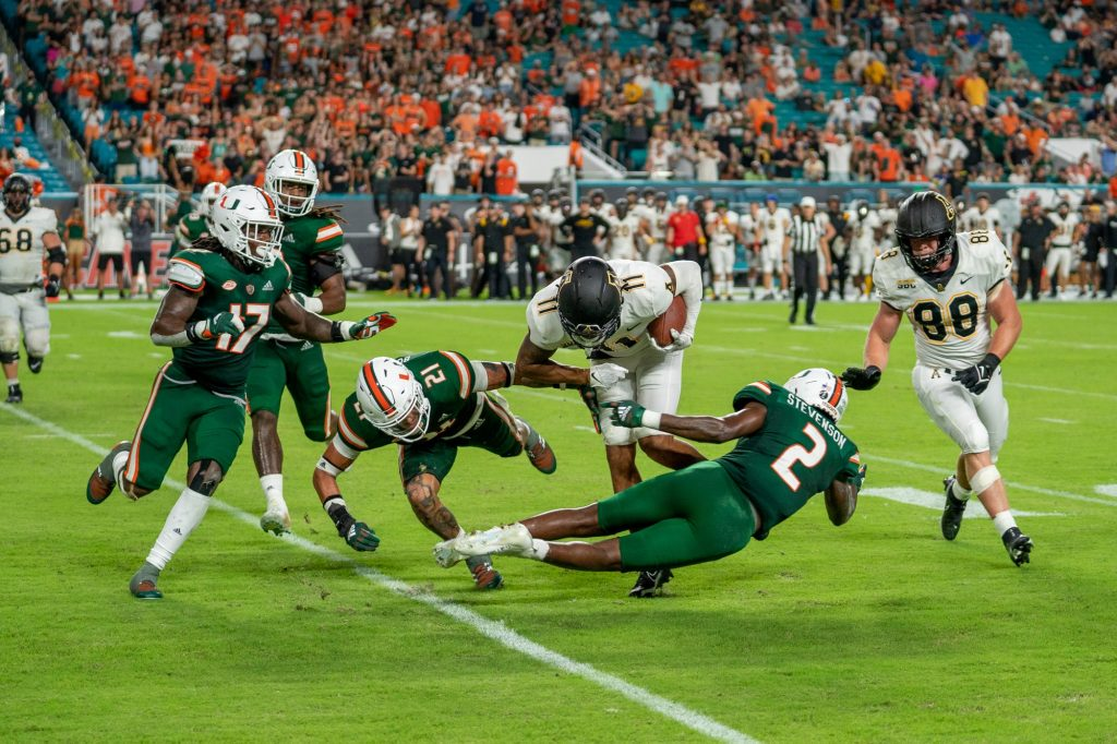 Redshirt junior safety Bubba Bolden and sophomore cornerback Tyrique Stevenson try to tackle Appalachian State wide receiver Jalen Virgil during Miami's game versus Appalachian State at Hard Rock Stadium on Sept. 11, 2021.