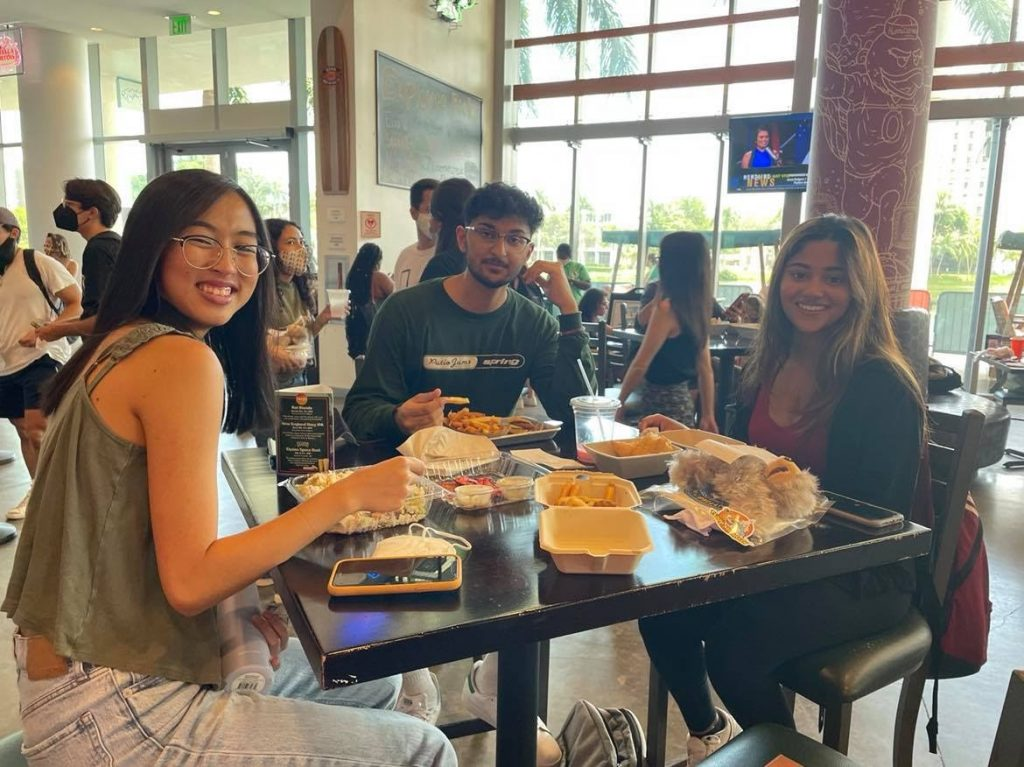 Bao Duong, Ishaan Shah and Amrutha Chethikattil enjoy their food and stuffed plushies at The Rat on Wednesday, Sept. 8. After a year of strict COVID-19 regulations, students anticipate a slow return to normality at the campus institution.