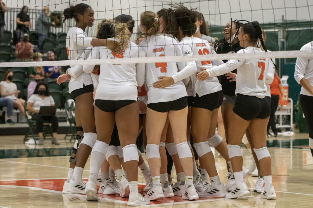 The University of Miami women's volleyball team celebrates after winning a point during their match against USF on Sept. 5, 2021 at the Knight Sports Complex in Coral Gables, Fl.