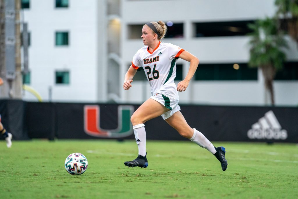 Junior defender Emma Tucker dribbles downfield during the second half of Miami's match versus Notre Dame at Cobb Stadium on Sept. 23, 2021.