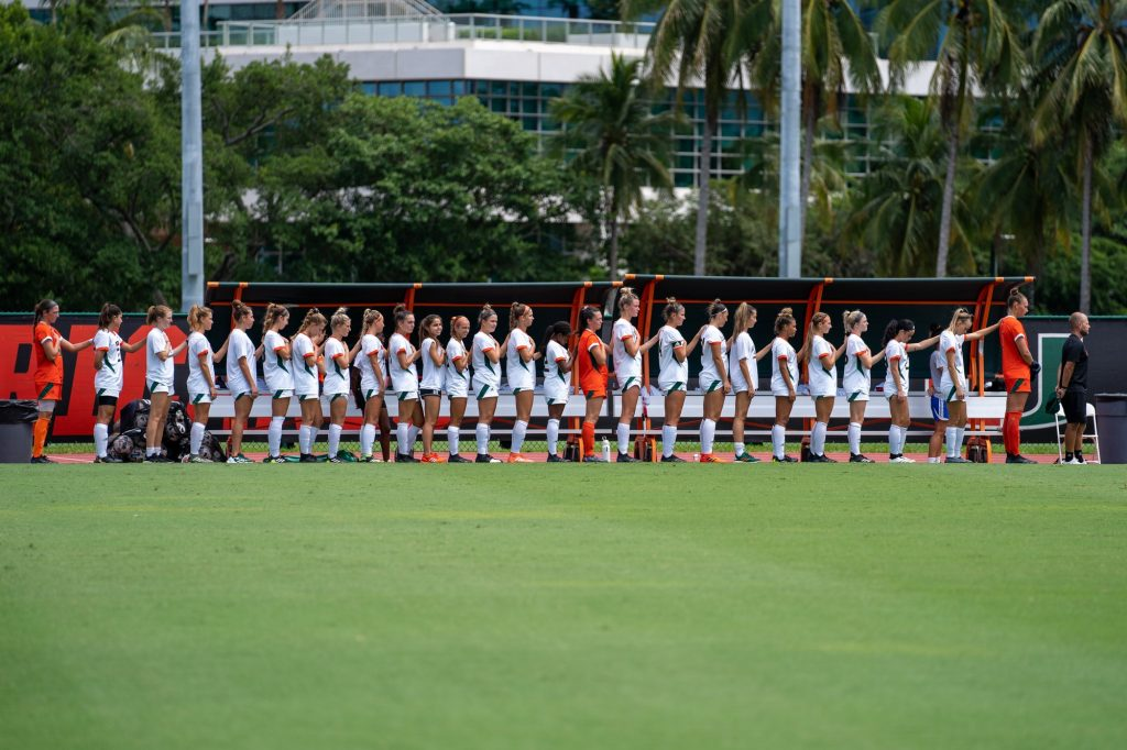 Canes soccer players stand for the national anthem before the start of their match versus USF at Cobb Stadium on Sept. 12, 2021.
