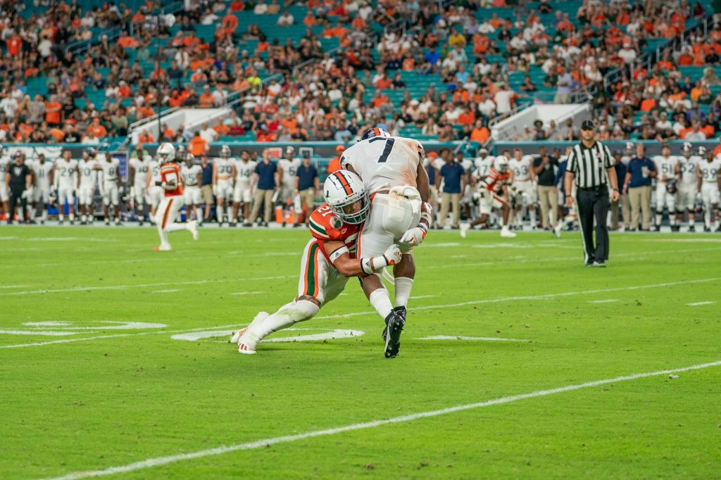 Redshirt junior safety Bubba Bolden tackles running back Mike Hollins during the second quarter of Miami's game versus the University of Virginia at Hard Rock Stadium on Sept. 30, 2021. Bolden finished the game with five solo tackles.
